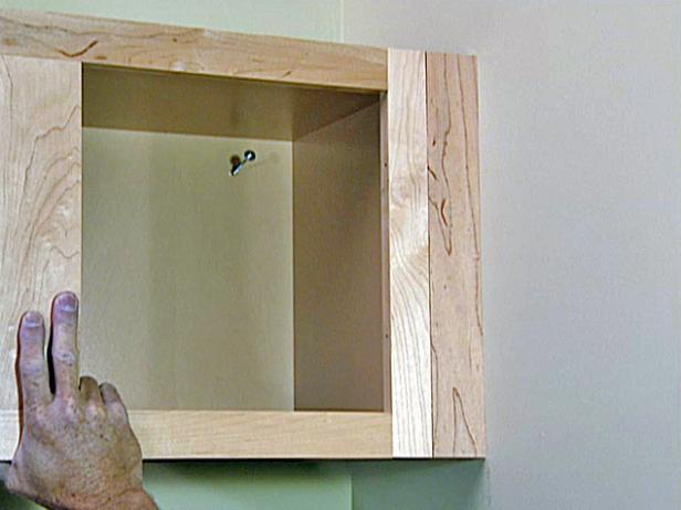 Hold the open-shelf unit against the corner cabinet (Image 2) and attach it using a nail gun. Then, re-hang two of the cabinet doors and make a few minor adjustments on the hinges to ensure that the doors hang and open properly.