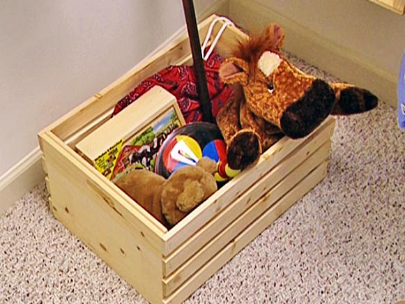crates placed on floor to catch toys