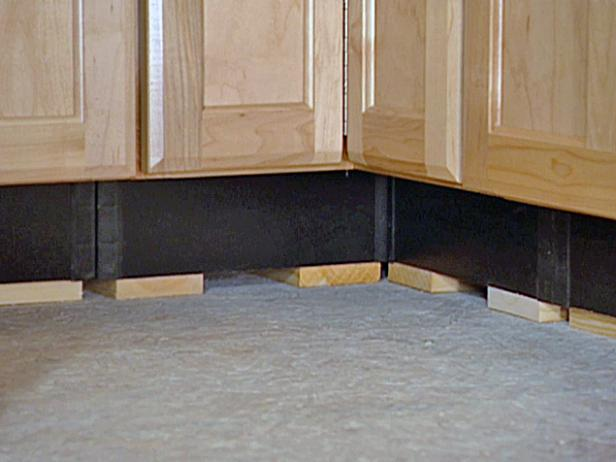Since the sink base will butt up against a blind corner at right angles, a 3-inch filler strip is installed on the sink base cabinet to ensure that the door will open properly.