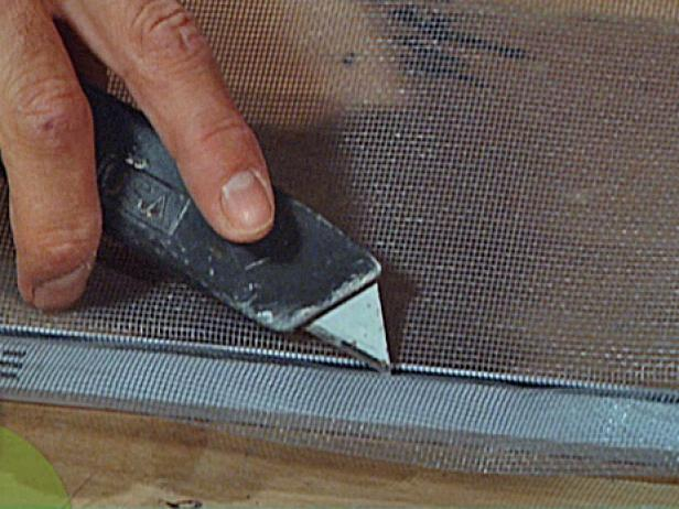 use utility knife to cut away excess screen