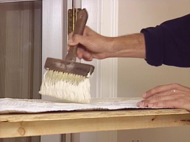 apply wallpaper adhesive to wall covering