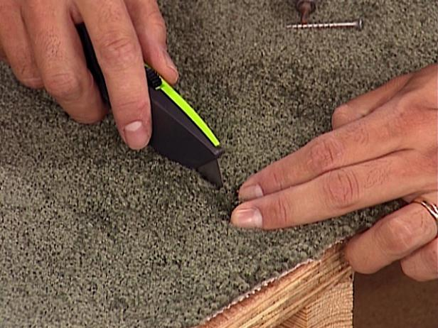 peel back carpet and use screw to subfloor