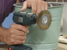 use metal brush attached to cordless drill