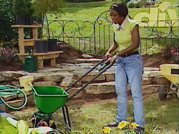 apply fertilizer with a walk behind spreader