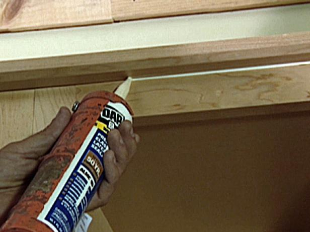 Once the molding is done, a bead of light-colored caulk is applied in the groove between the upper cabinet and molding to conceal the seam (Image 1).
