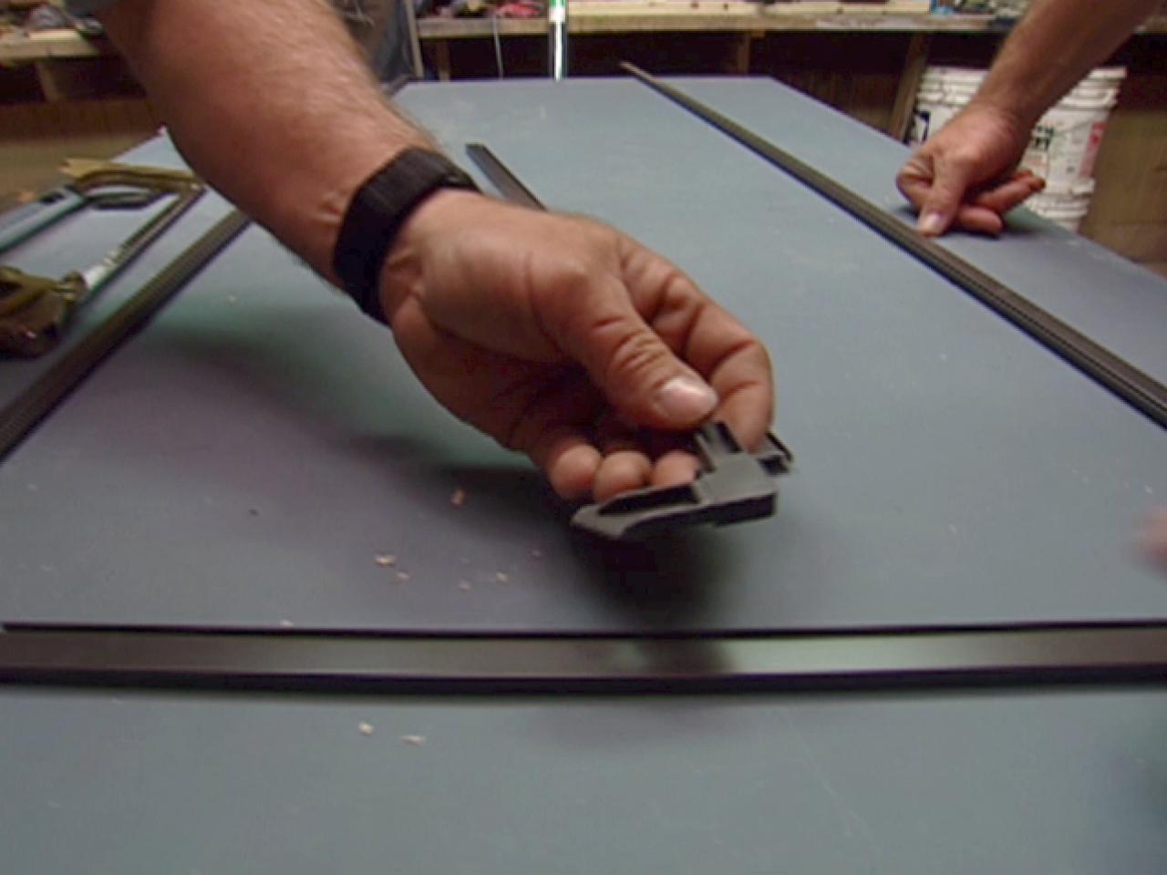 cut metal frame stock using hack saw and miter box