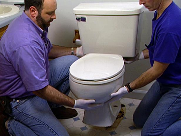 gently rock toilet back and forth to lift it free