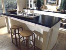 kitchen island sink used for food preparation