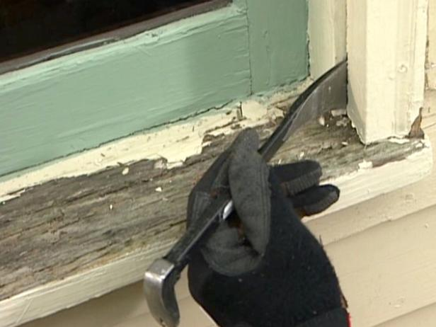 use pry bar to remove old caulk and exterior trim