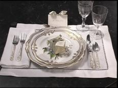 elegant favor boxes are aded to place setting