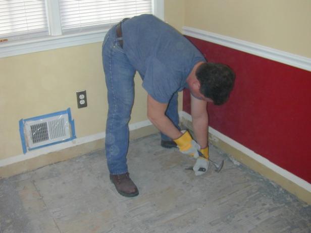 clean subfloor of adhesive
