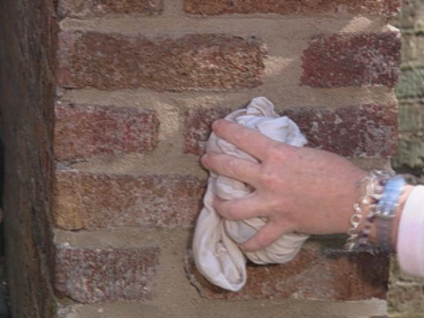 use damp cloth to lightly tamp over mortar joints