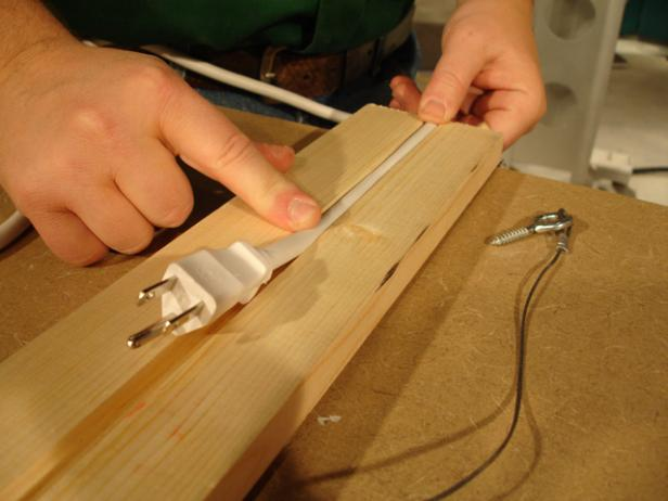 use router to cut groove for power cord