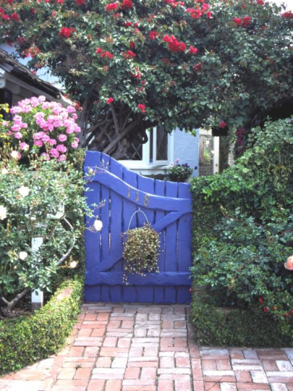 a gate makes a bold artistic statement to a home