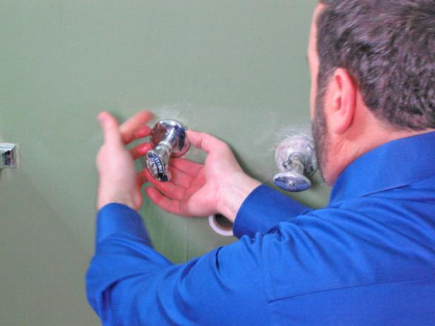 Apply Teflon tape on both stub outs, and then add new escutcheon covers by sliding the cover over the roughed in water supply. Thread new supply stops on both and use a wrench to tighten everything up. Ensure that the inlet valve is in the upright position.