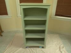 apply base coat of paint to bookcase