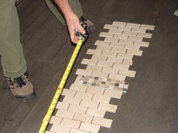 Before you start setting the tile, take some measurements and see how the pattern will lay out (Image 1).