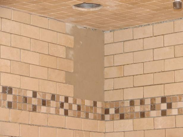 You can add a decorative mosaic border near the top of the shower walls. This three-inch border is set between the second and third panel from the top.