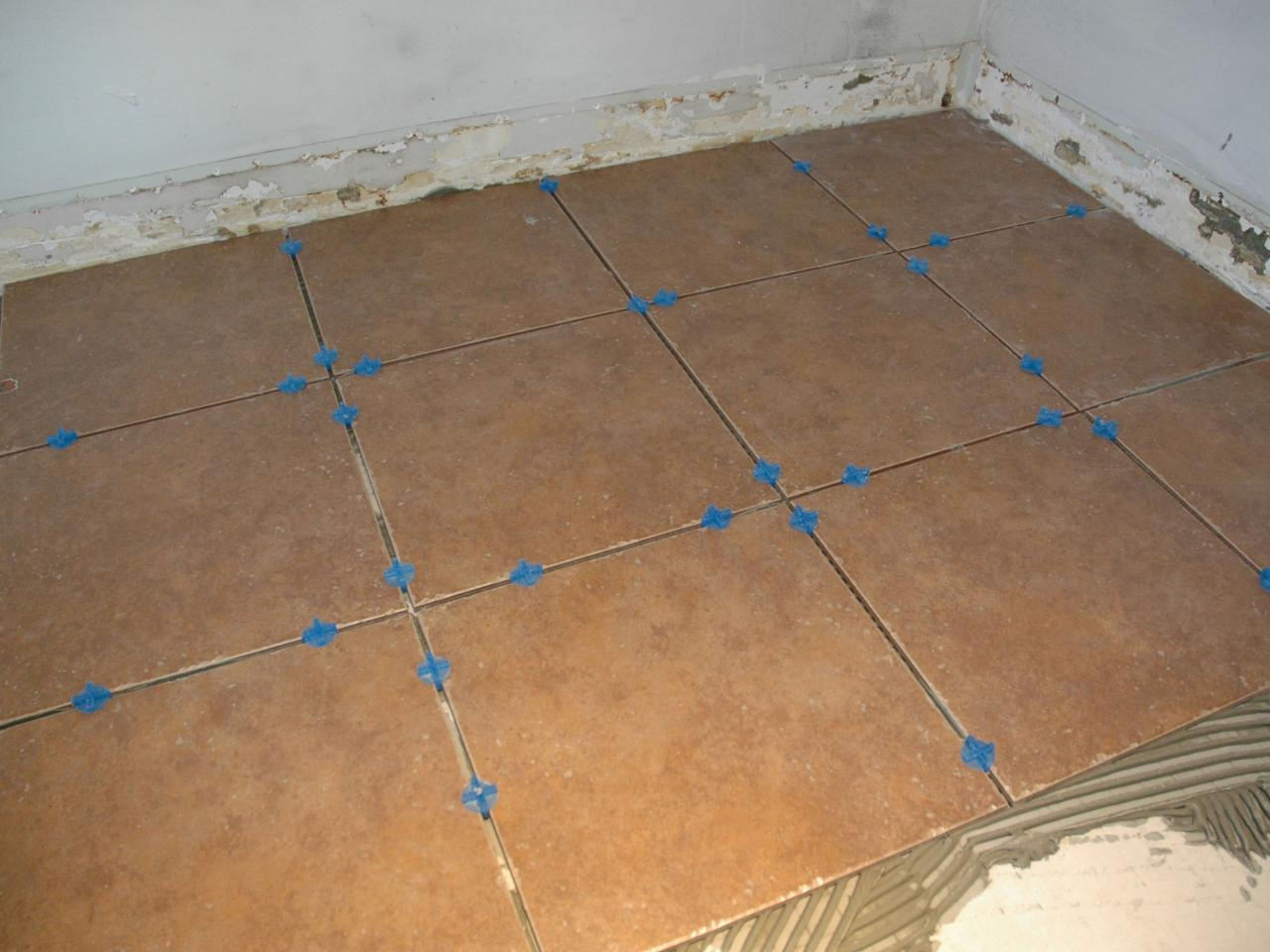 How to install a tile floor in a kitchen how tos diy spread thinset dailygadgetfo Gallery