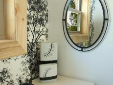 guest bathroom has black and white theme