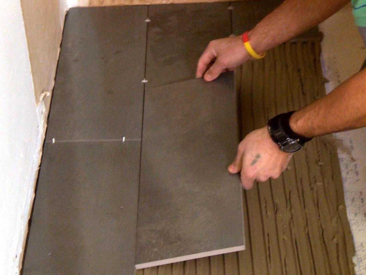 How to install a plank tile floor how tos diy dkim109plank tile floor spread mortar 2s4x3 dailygadgetfo Image collections