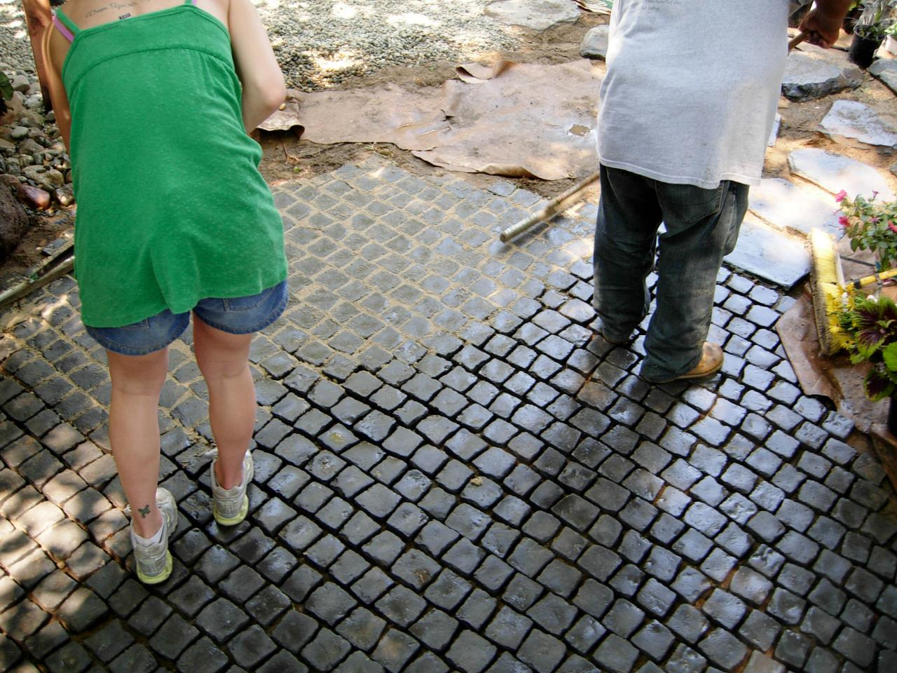 how to install a cobblestone patio on concrete or bare soil how