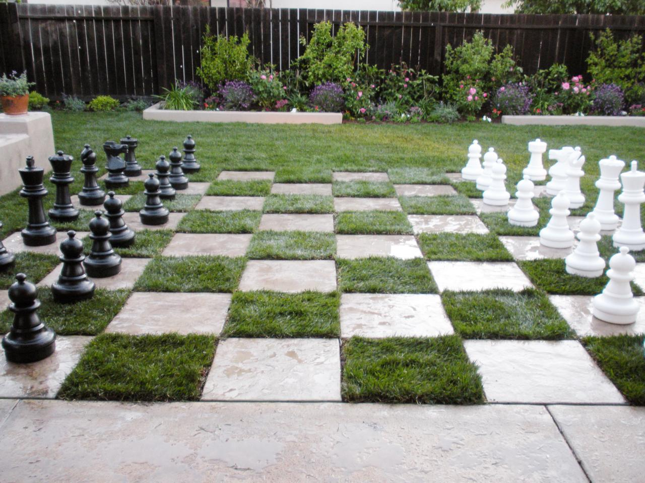 Backyard chessboard patio this yard becomes the ultimate for Patio ideas images