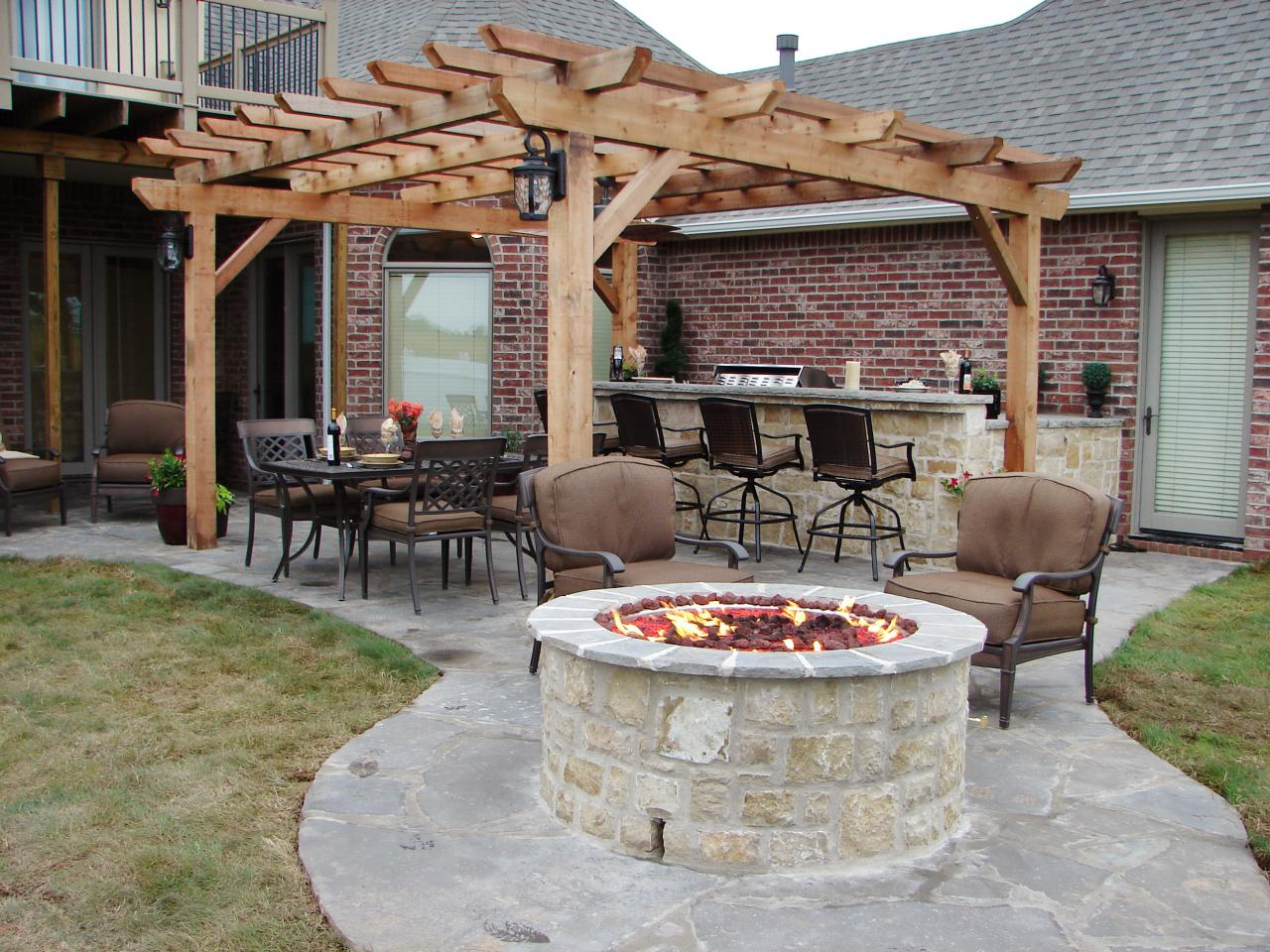 66 fire pit and outdoor fireplace ideas diy network blog for Outdoor patio fireplace ideas