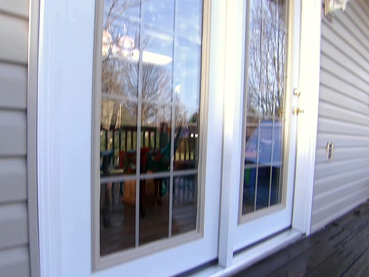 Replacing a slider with hinged doors how tos diy for Sliding glass door to french door