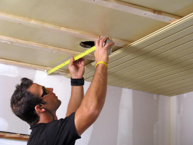 Measuring the wooden planks on the ceiling. - How To Install A Tongue-and-Groove Plank Ceiling How-tos DIY