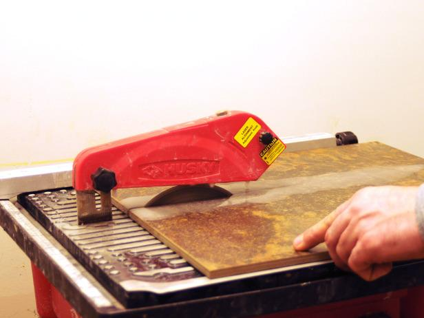Using a wet saw to cut tile.