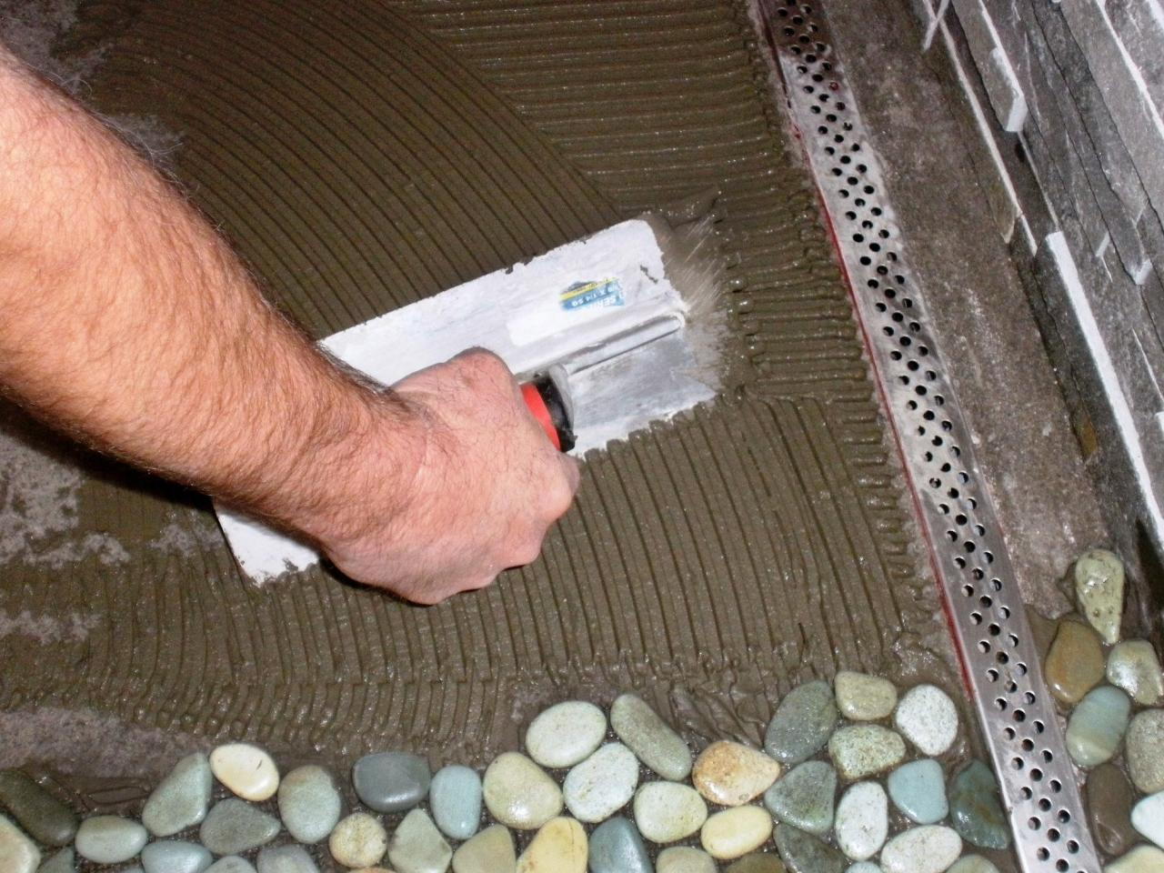 Laying Kitchen Floor Tiles How To Lay A Pebble Tile Floor How Tos Diy