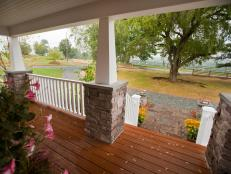 With tapered Arts-and-Crafts-style columns and durable decking, the front porch provides the perfect perch to relax and enjoy the country landscape.