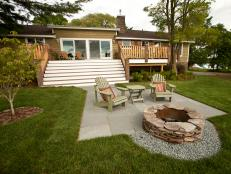 With a remodeled back deck, stadium-style stairs and a flagstone patio with custom fire pit, the backyard commands attention.