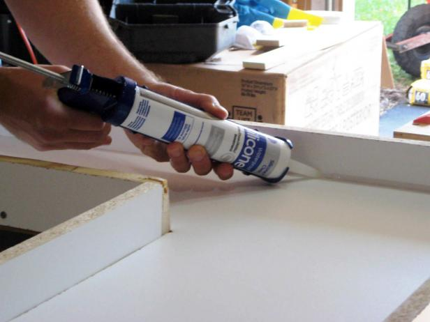 Run a small uniform bead of 100-percent silicone caulk in all the inside corners and seams of the mold. Smooth the bead with a caulk tool or your finger and let dry thoroughly for 24 hours.