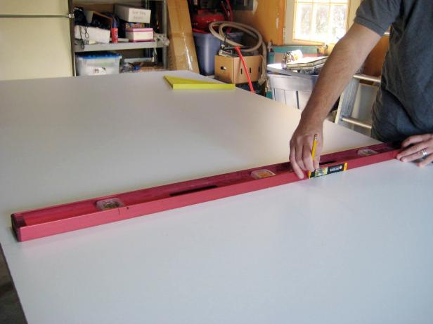 Measure and mark the exact dimensions on the mold base, then cut using a circular saw (image 2).