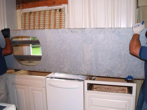 It's important to always carry the countertops in a vertical position, never horizontally flat, to avoid cracking or breaking the stone. To transport granite slabs, carry them on edge in an A-frame rack, the way glass is carried. If needed, you can make a simple rack from 2x4s. Protect the edges by covering them with wide painter's tape.