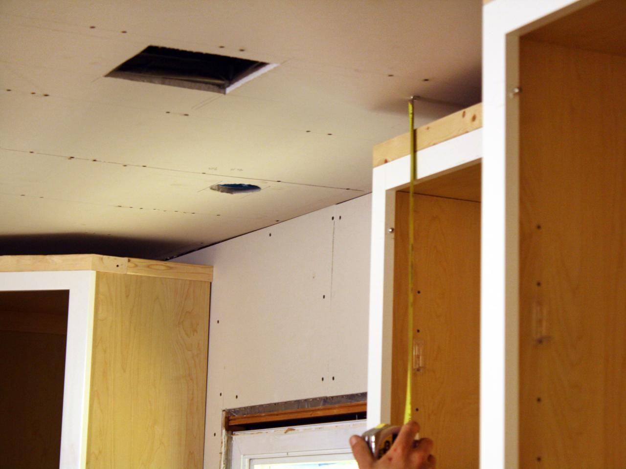 How to install kitchen cabinet crown molding how tos diy for Cabinet installation