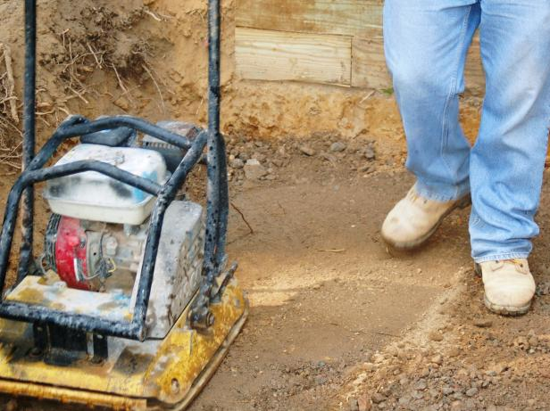 Use a plate compactor to compact the gravel, creating a firm and long-lasting base for the patio.