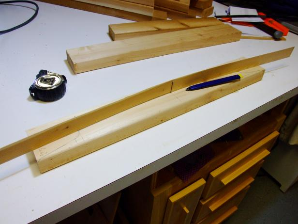 For marking the top arc, use a thin strip of wood or a flexible metal ruler. Drive in nails or brads to hold the wood strip or ruler in place while marking