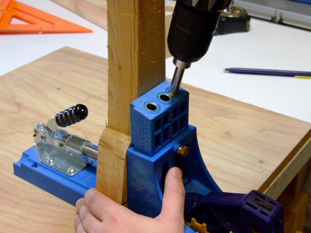 Set the pocket-hole jig and drill bit for drilling into 1 1/2 inch stock and drill the pocket holes in the front aprons.