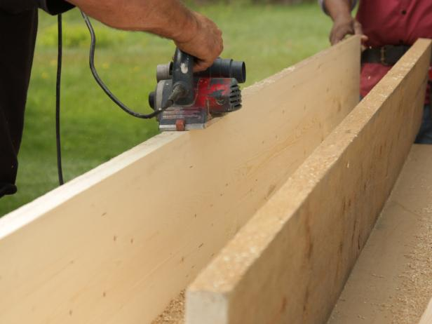 Sand the tabletop with a wide-belt hand-held sander. Keep belt perpendicular to plank joints and move back and forth in a direction parallel to joints.