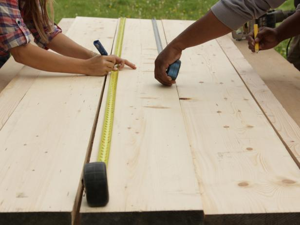 Lay the four best planks out on a flat surface and arrange them in final position. With a pencil and working across two boards at a time, make a mark at every 8-inch point along the seam of two boards.