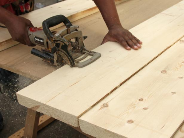 With a pencil and working across two boards at a time, make a mark at every 8-inch point along the seam of two boards. After marks are made, use the joiner to cut the biscuit slots at each location.