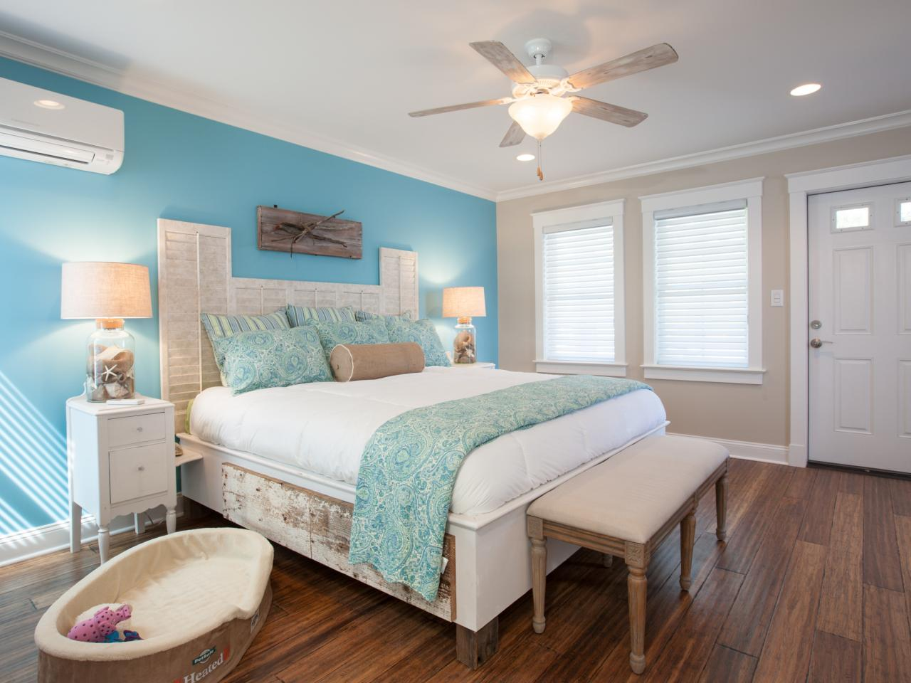 blue and tan master bedroom a city view navy white restoration