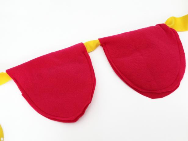 Sewed fabric petals strung on ribbon
