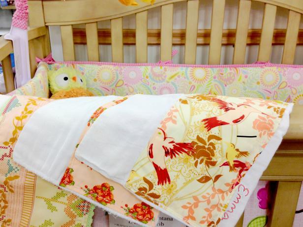 CI-Jess-Abbott_Embellished-burp-cloths-on-crib_h
