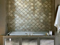 Moroccan Style Bathtub Niche With Metallic Tile Backsplash