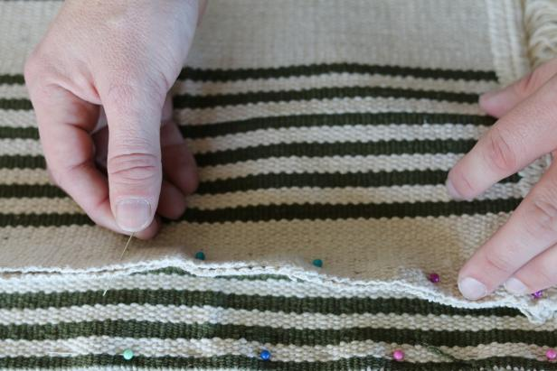 Use the sewing pins to temporarily attach each of the four side panels to the top panel. Leave one of the four panels unstitched so the pet bed can be inserted.