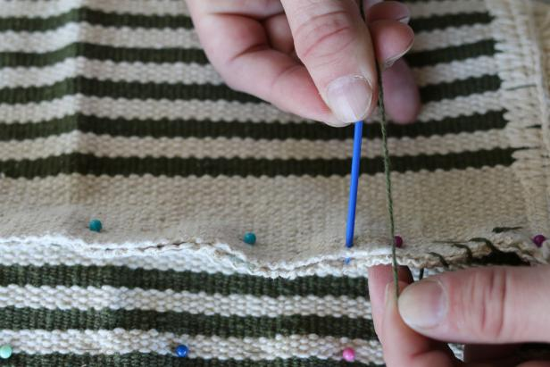 Thread round-ended tapestry needle with mercerized cotton then sew the bottom panel to the three of the four side panels.